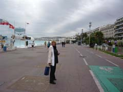 Sue strolling along the beach in Nice
